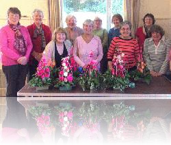 Another photo of flower arrangers in Great Oakley Village Hall.